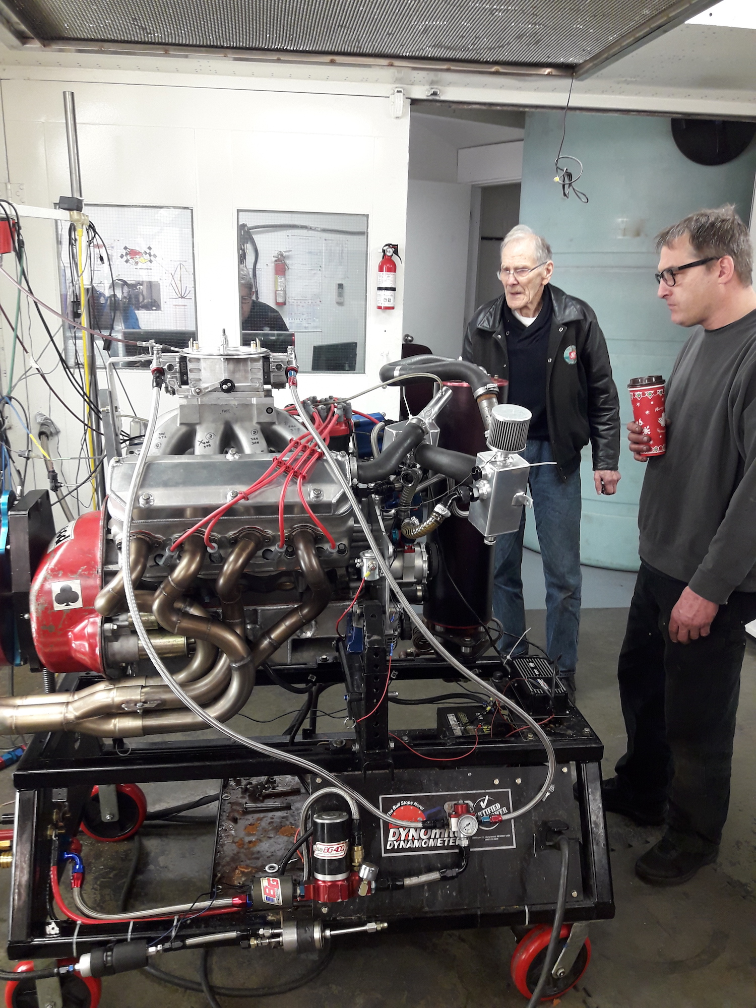 two men examine an engine