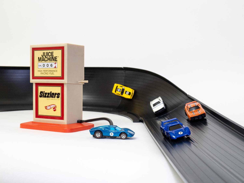 miniature motorized cars on track