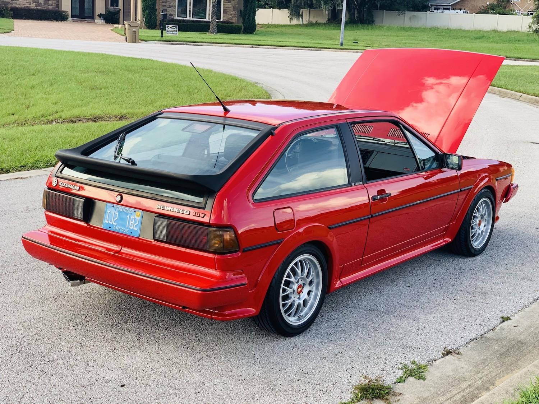 red 1986.5 Volkswagen Scirocco 16V rear three-quarter