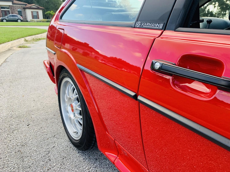 red 1986.5 Volkswagen Scirocco 16V rear side