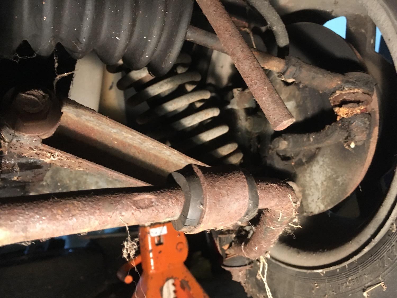 old worn broken sway bar link closeup