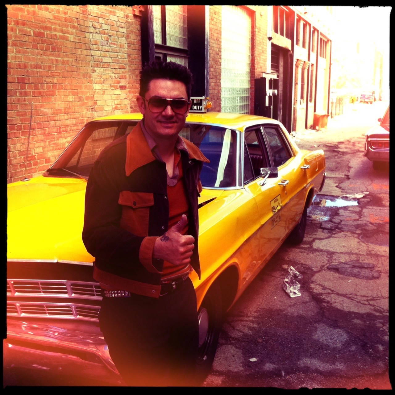 milburn in character on set with taxi