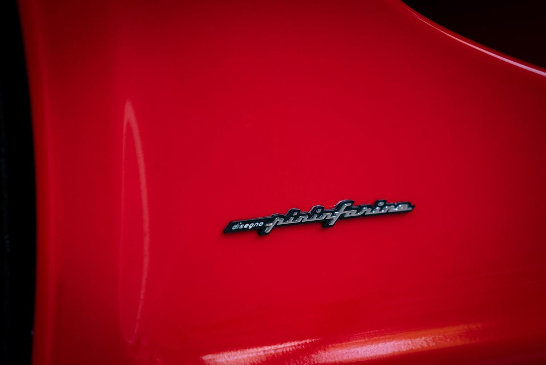 1995 red chrome pininfarina badge