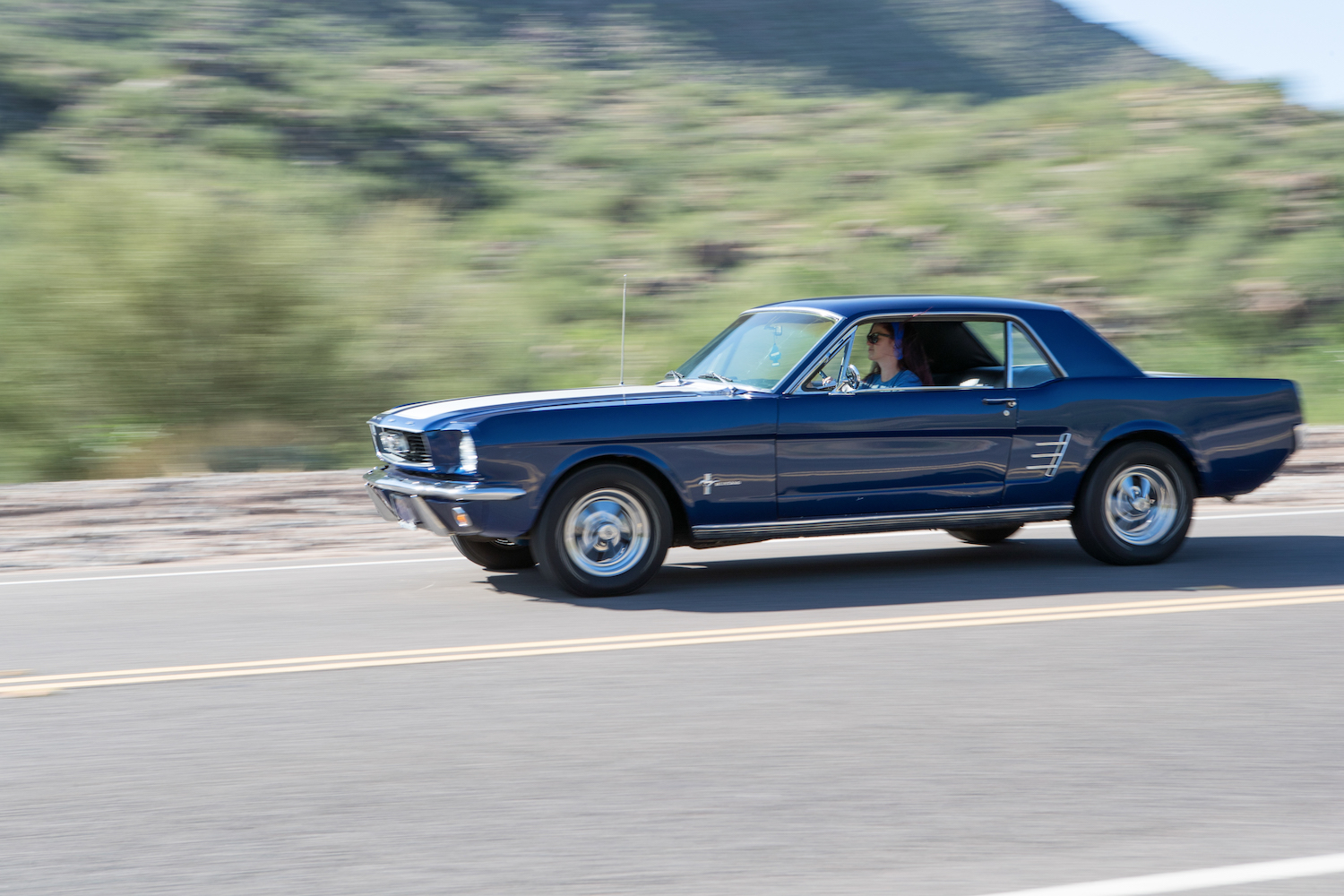blue ford mustang front three-quarter