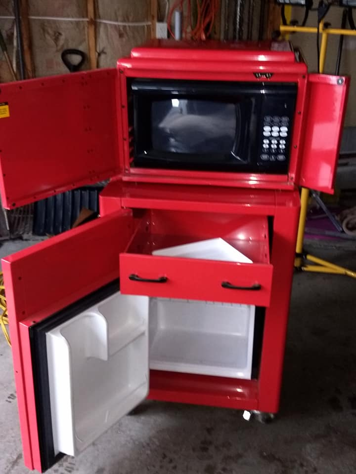 red front tool themed refrigerator microwave doors open