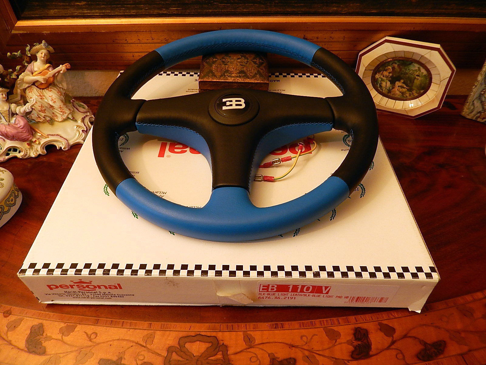 black and blue bugatti personal wheel