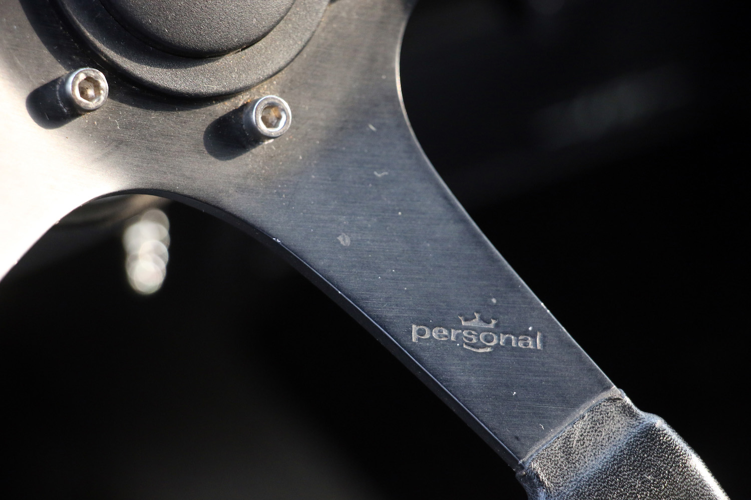 personal steering wheel brand etching close up