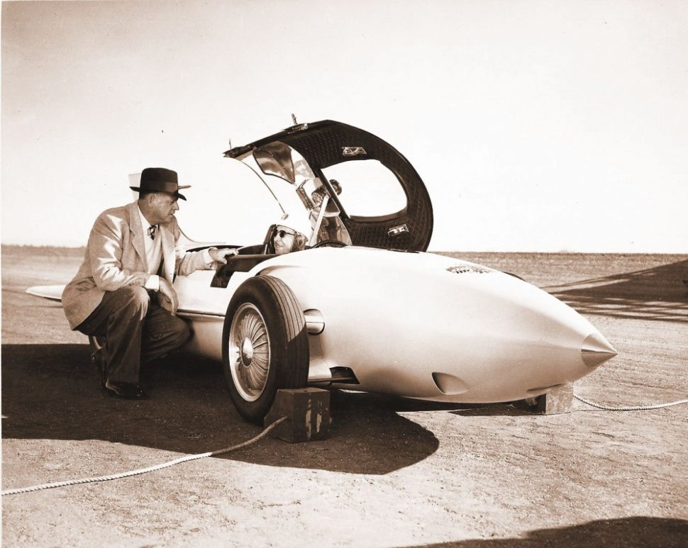 gm executive beside rocket firebird car