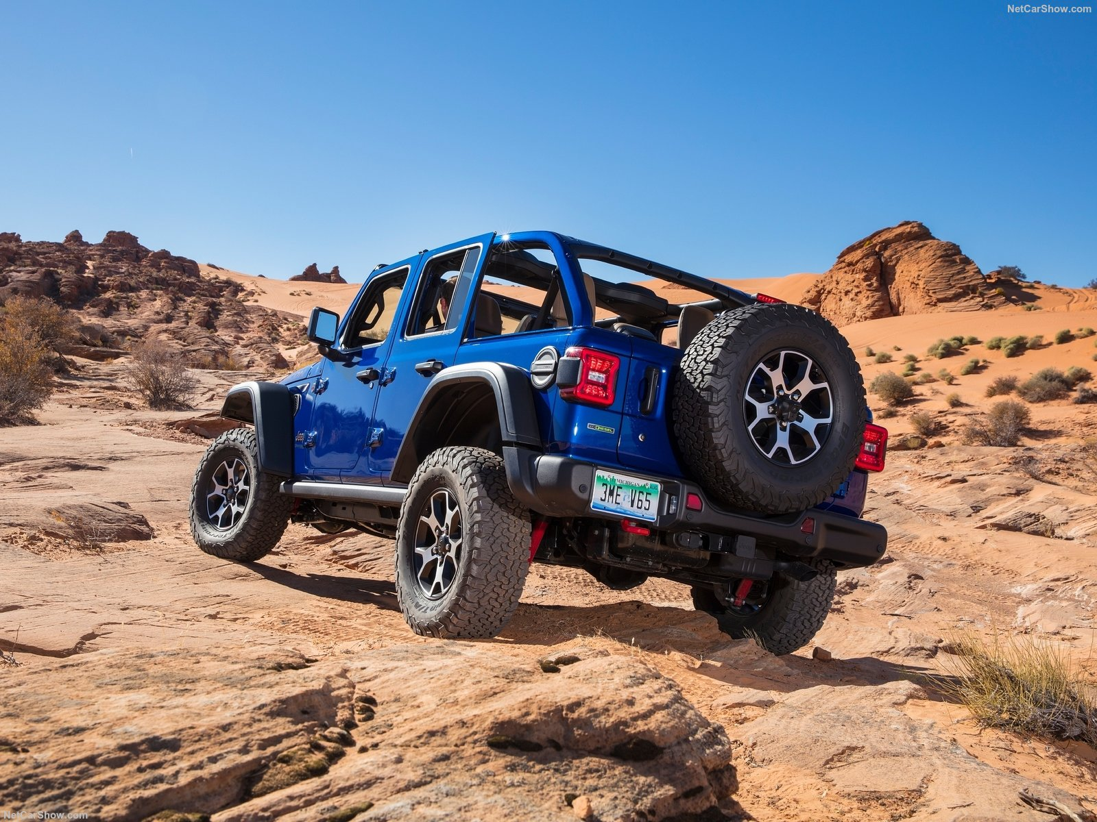blue rubicon off road rear three-quarter