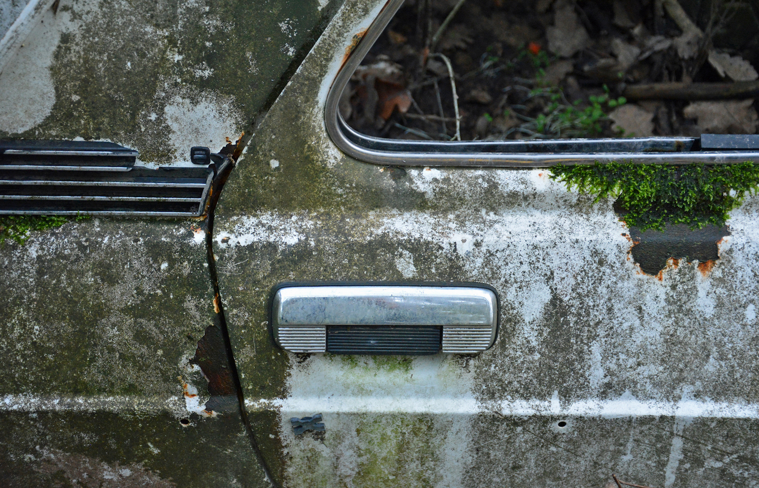 abandoned old car door handle close-up