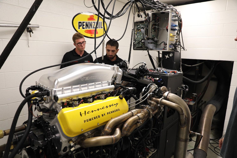engineers test engine