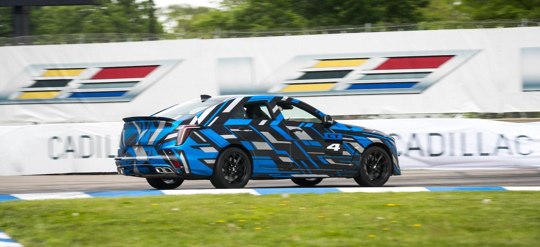 ct5-v rear three-quarter on track in motion