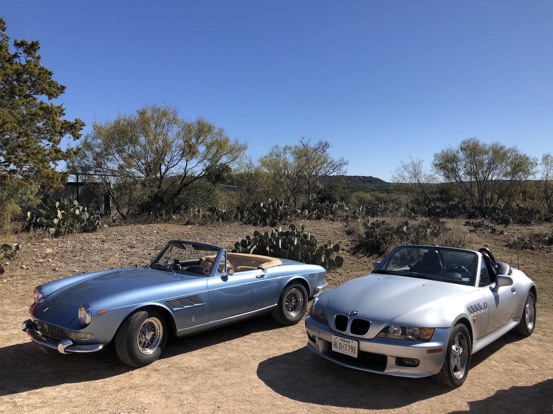 bmw z3 parked on dirt beside alfa