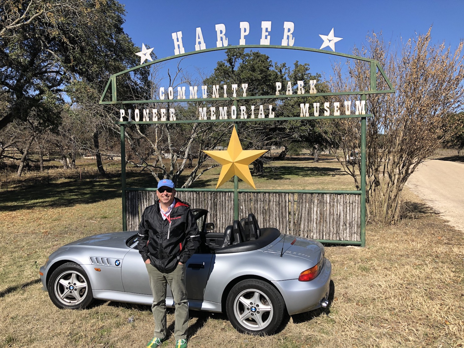 man standing beside z3 in front of museum sign