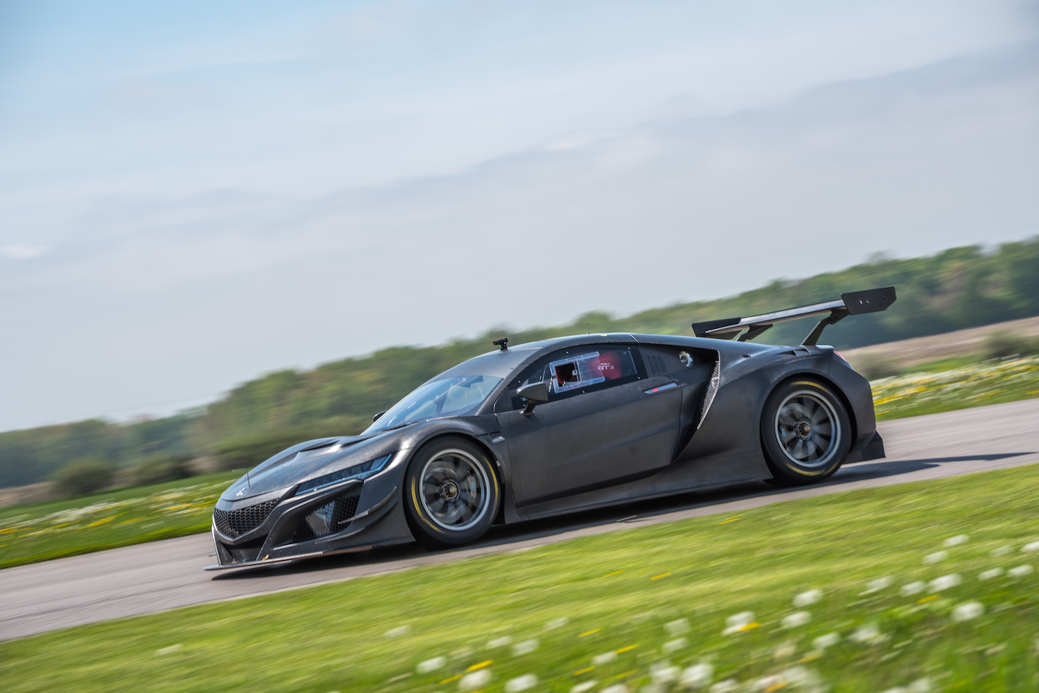 nsx gt3 race car on track side-view