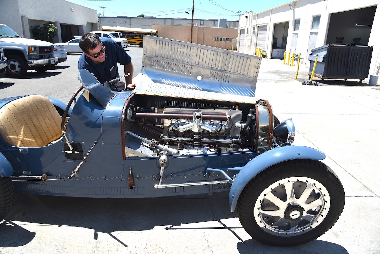 open old bugatti engine cover