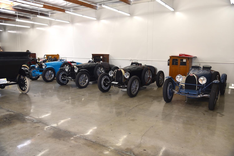 vintage bugattis in garage