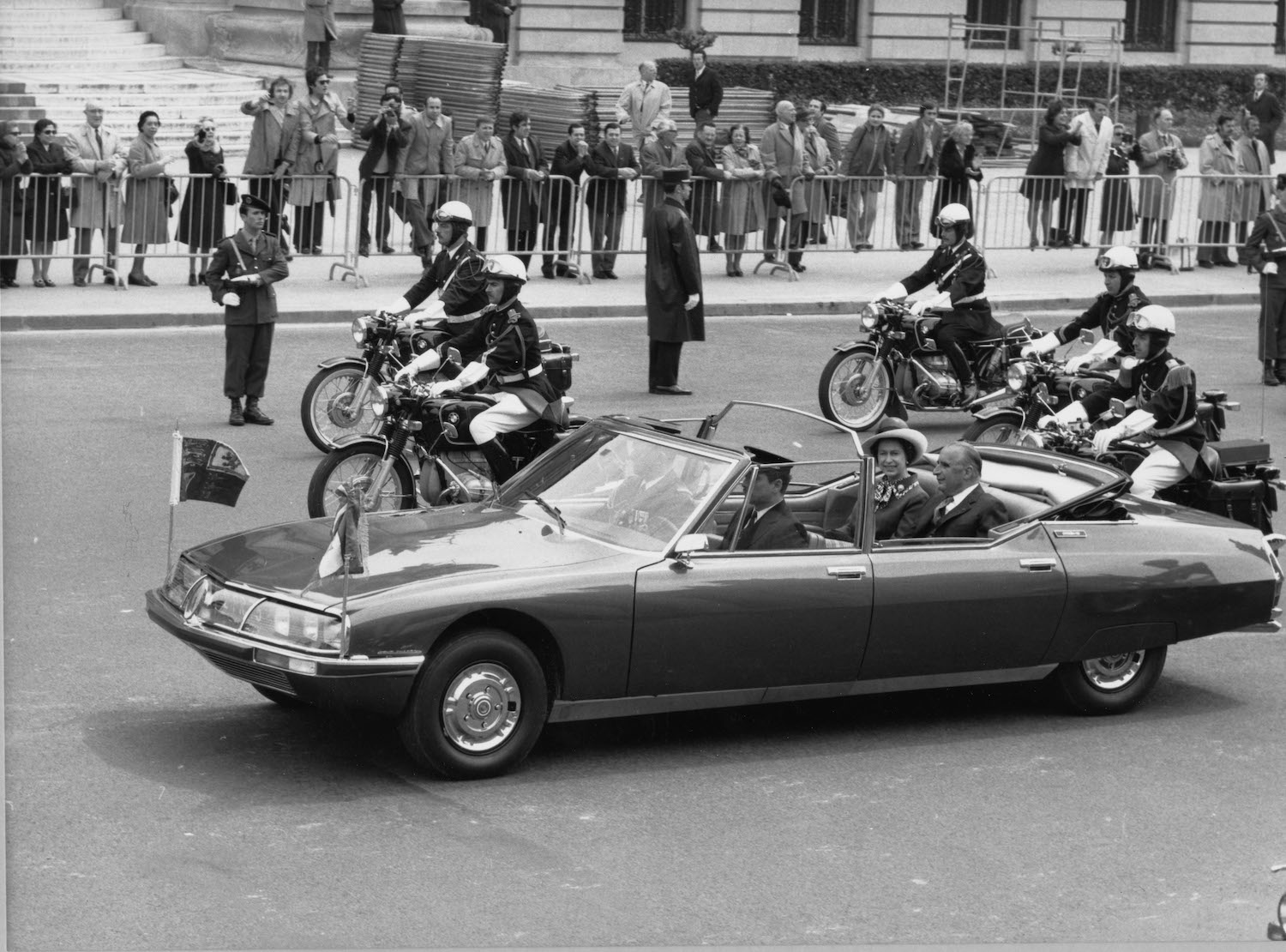 president and wife ride in citroen in parade