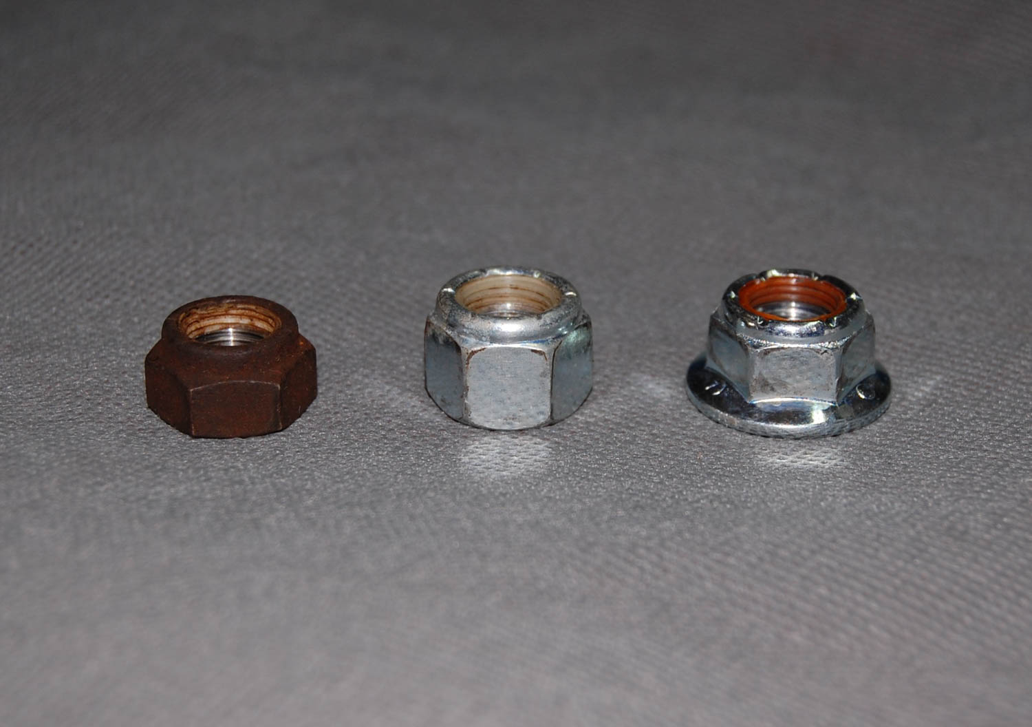 Left to right, the original, corner hardware store, and McMaster-sourced nyloc fasteners.