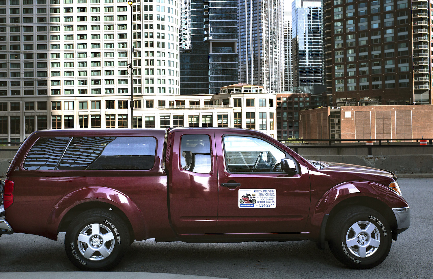 million mile 2007 nissan frontier in city side-view