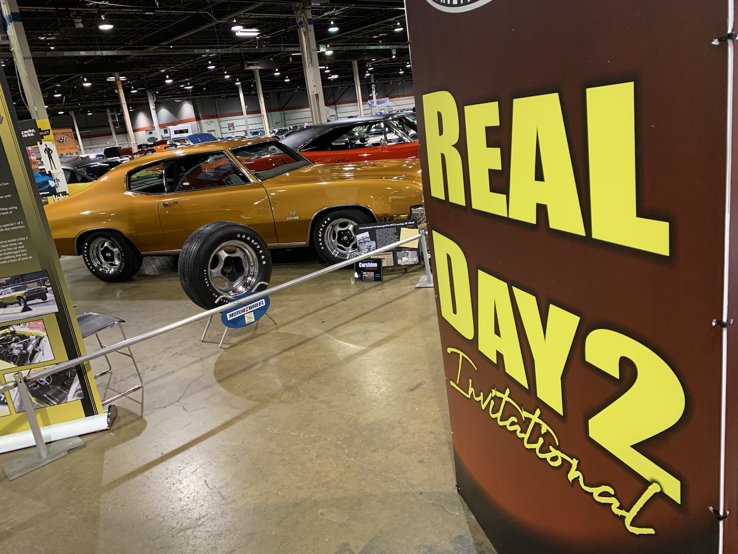 mcacn show banner and muscle car