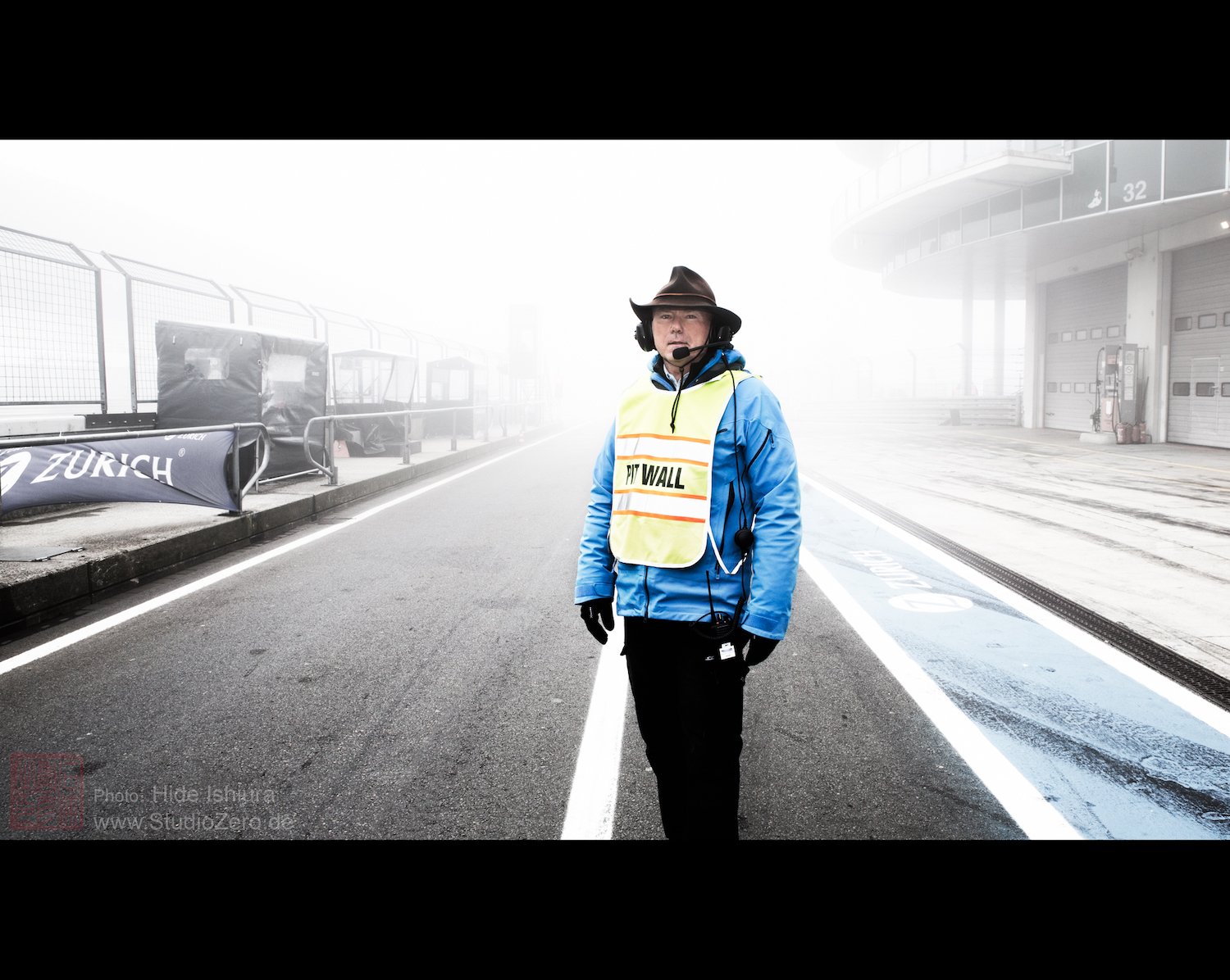 man stands alone on race track