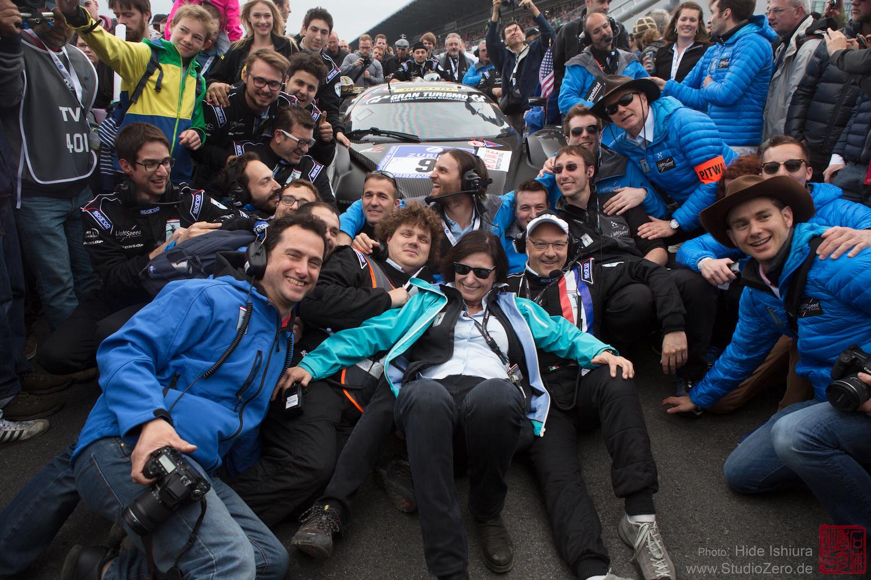 racing team celebrating together
