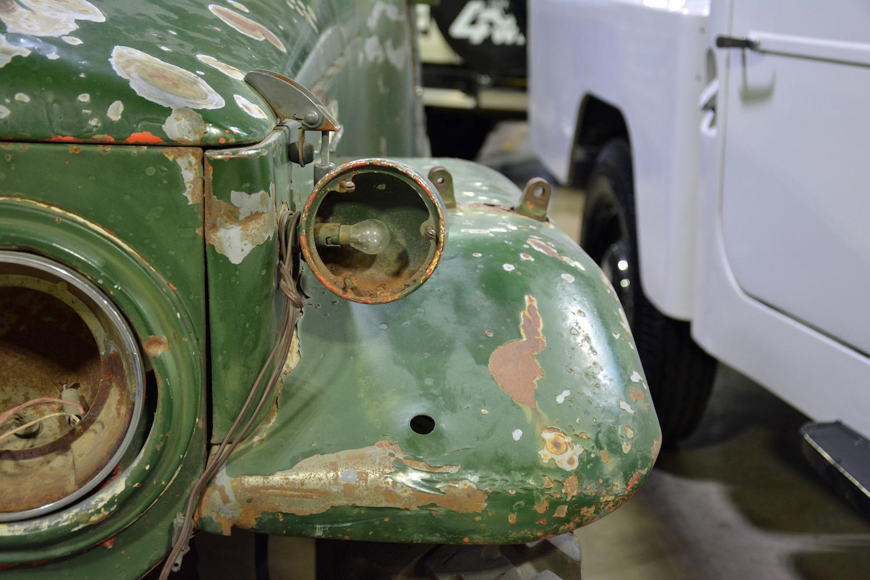1965 Toyota FJ45LV broken light housing closeup
