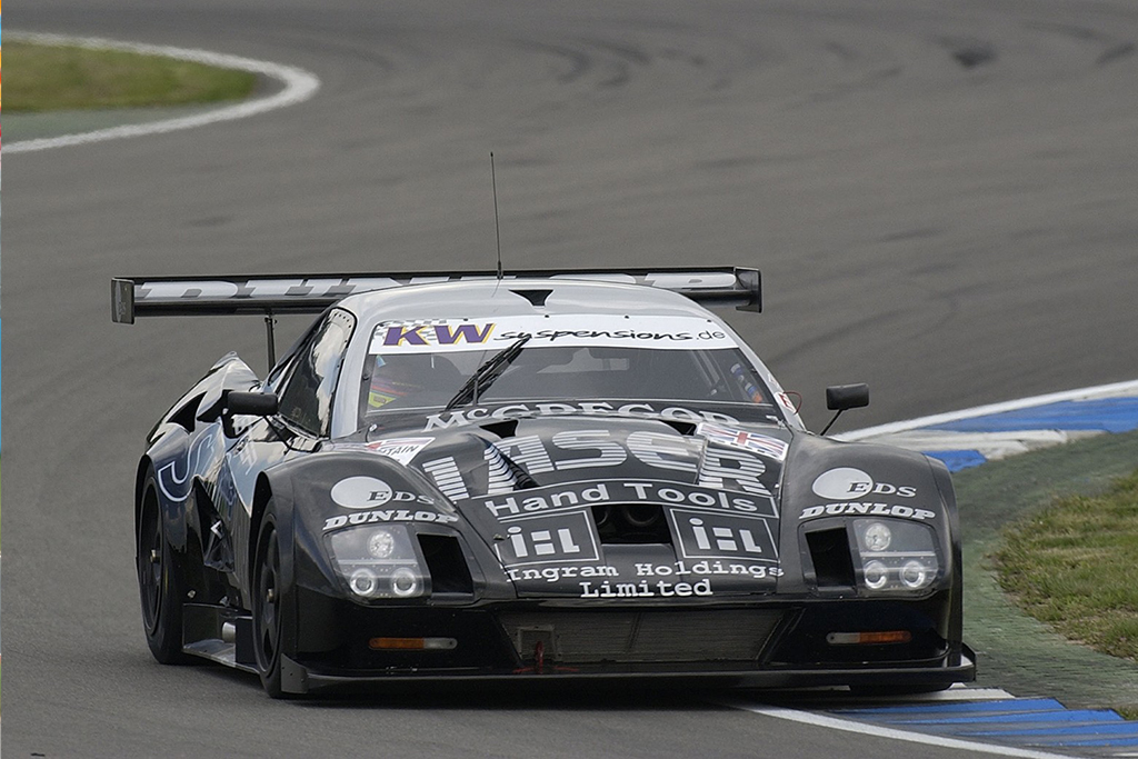 lister storm race car front on track action