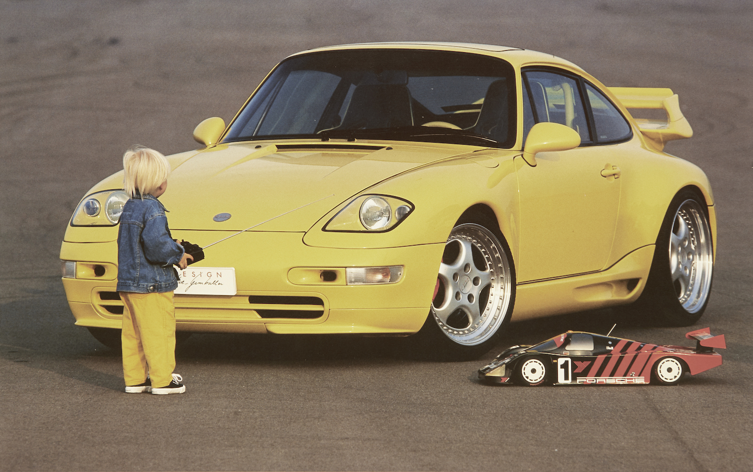 gemballa porsche front three quarter and boy with rc car