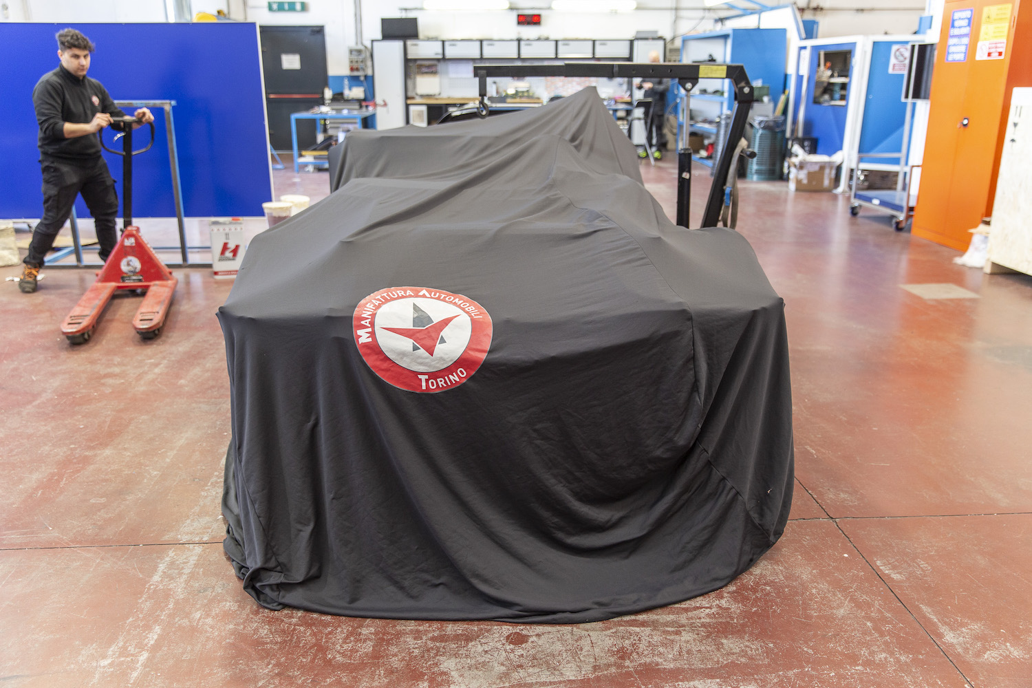 car front under cover in garage