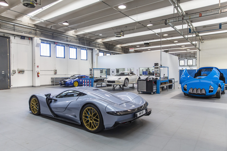 supercar rear three-quarter in garage