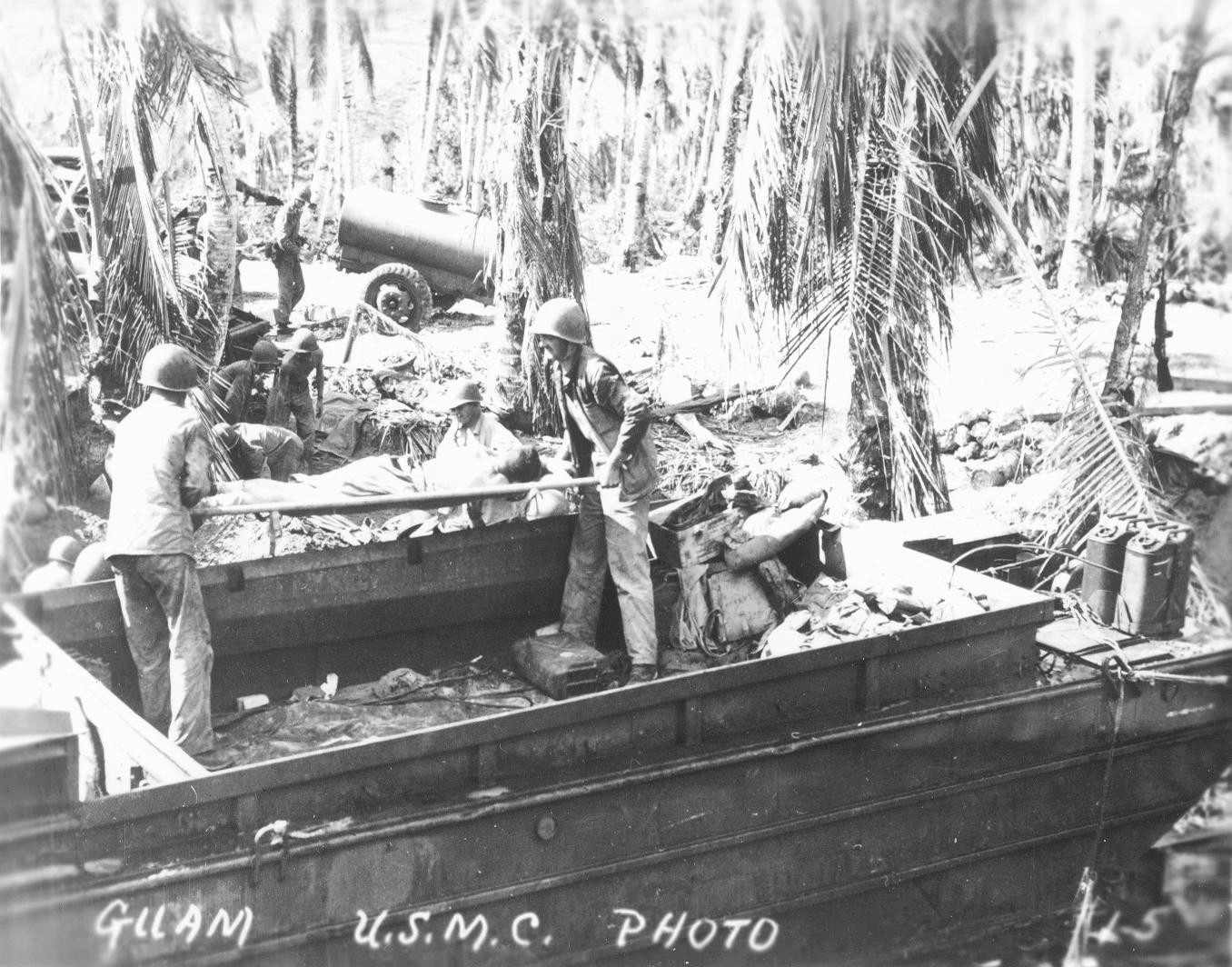two marines unload wounded man from duck in guam