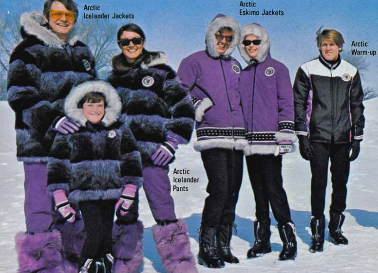 family dressed in Arctic Cat snowmobile outerwear