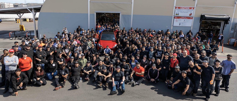 group photo of tesla employees