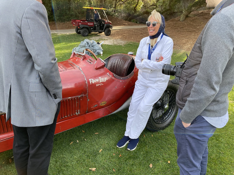 alfa romeo race car woman dressed in race suit attire