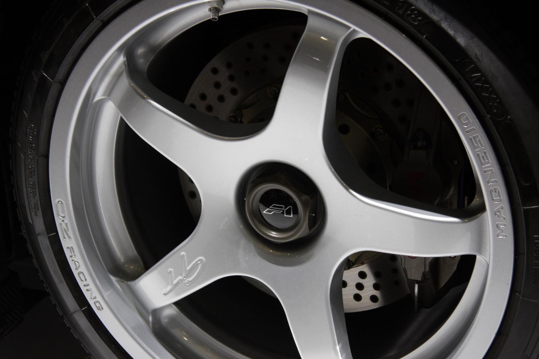 green mclaren gt wheel closeup