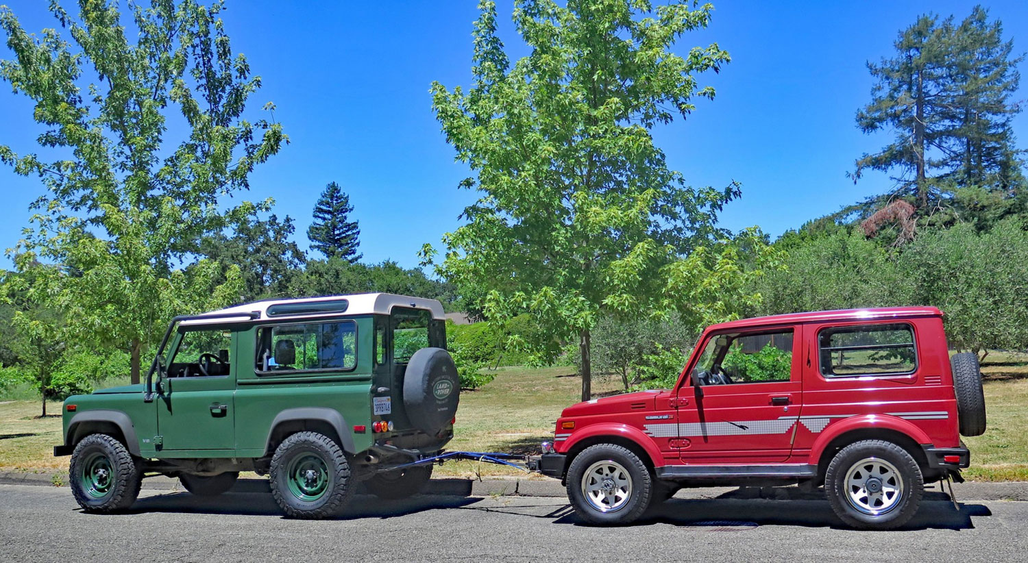 The Samurai is dwarfed by a Defender 90, even though its wheelbase is only a foot longer.