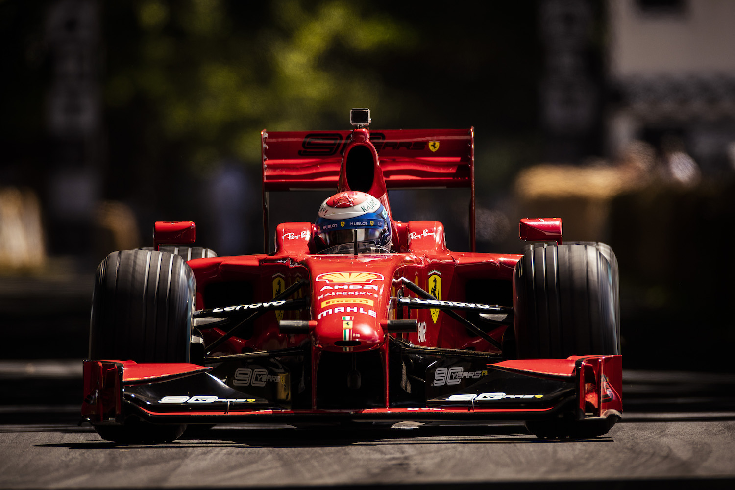 ferrari formula one race car front with driver in cockpit