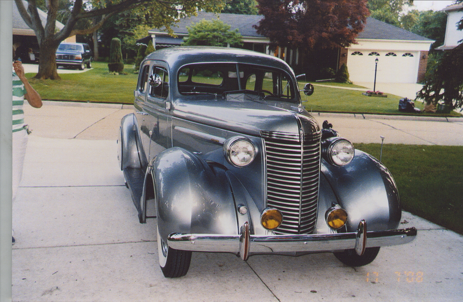 restored 1938 nash sedan front three-quarter in driveway